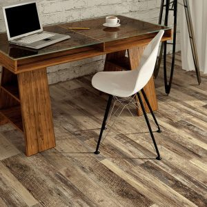 Laptop on table | Assured Flooring