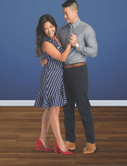 Couple dancing on Vinyl floor | Assured Flooring